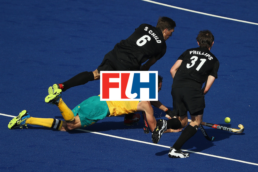RIO DE JANEIRO, BRAZIL - AUGUST 06:  Mark Knowles #9 of Australia falls to the defense of Blair Hilton #9 and Hayden Phillips #31 of New Zealand during a Pool A match between New Zealand and Austraiia  on Day 1 of the Rio 2016 Olympic Games at the Olympic Hockey Centre on August 6, 2016 in Rio de Janeiro, Brazil.  (Photo by Sean M. Haffey/Getty Images)