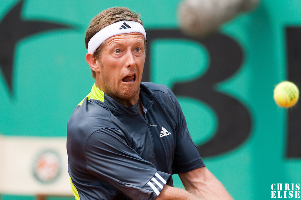 04 June 2007: Jonas Bjorkman of Sweden eyes the ball as he prepares a backhand shot  to Carlos Moya of Spain during the French Tennis Open fourth round match won 7-6(5), 6-2, 7-5 by Carlos Moya over Jonas Bjorkman on day 9 at Roland Garros, in Paris, France.