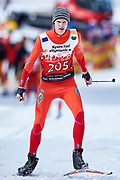 Schladming, Austria - 2017 March 20: Edgars Grigorjevs from SO Latvia competes in Cross Country Race while Special Olympics World Winter Games Austria 2017 in Ramsau am Dachstein on March 20, 2017 in Schladming, Austria.<br /> <br /> Mandatory credit:<br /> Photo by &copy; Adam Nurkiewicz / Mediasport<br /> <br /> Adam Nurkiewicz declares that he has no rights to the image of people at the photographs of his authorship.<br /> <br /> Picture also available in RAW (NEF) or TIFF format on special request.<br /> <br /> Any editorial, commercial or promotional use requires written permission from the author of image.<br /> <br /> Image can be used in the press when the method of use and the signature does not hurt people on the picture.