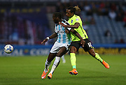 Huddersfield Town striker Ishmael Miller and Brighton defender, full back, Gaetan Bong during the Sky Bet Championship match between Huddersfield Town and Brighton and Hove Albion at the John Smiths Stadium, Huddersfield, England on 18 August 2015.