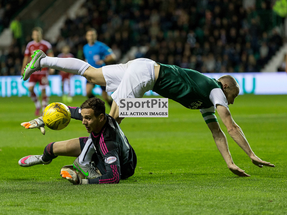 Hibernian FC v Aberdeen FC<br /> <br /> Danny Ward gets to ball before David Gray (Hibernian captain) during the Scottish League Cup clash between Hibernian and Aberdeen FC at Easter Road Stadium on 23 September 2015.<br /> <br /> <br /> Picture Alan Rennie.