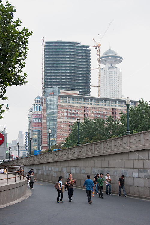 street scene in Shanghai China, skyscrapers in background
