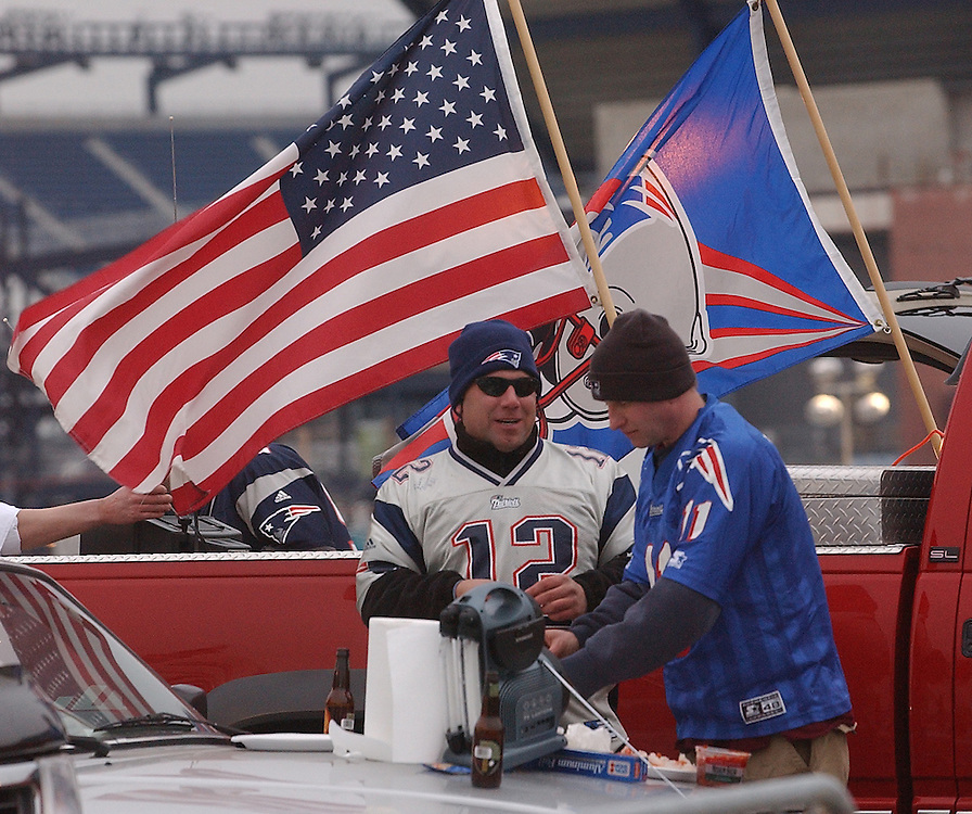 (1/19/02 Foxboro, MA) Patriots vs. Raiders at Foxboro Stadium.Lois Mastrachio, #12, and Tim Huminski, #11, tailgate prior to the start of the game. (011902patsmjs.JPG- Staff Photo by Michael Seamans. Saved in Sunday/FTP)