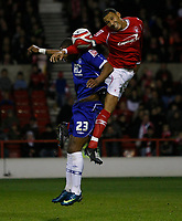 Photo: Richard Lane/Richard Lane Photography. Nottingham Forest v Birmingham City. Coca Cola Championship. 08/11/2008. Marcus Bent (L) and Kelvin Wilson (R) in an aeriel challange