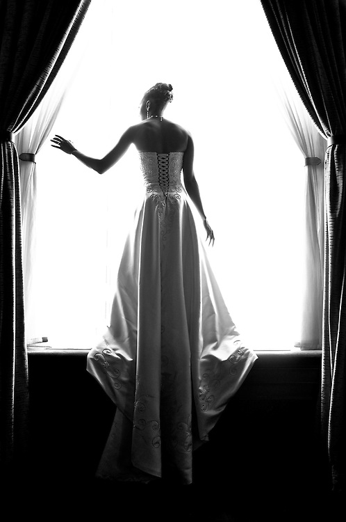 Beautiful Uzoezi at a window of the Julia Morgan Ballroom, Merchant's Exchange, San Francisco