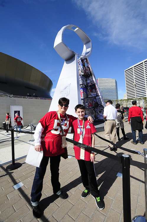 2/3/13 New Orleans LA.-NFL San Francisco 49er's fans Nancy Branton, from Jackson MS and her nephew Isaac Dubofsky 13, from Chicago have their photo made with the Lombardi Trophy at Super Bowl XLV11 outside the Mercedes Benz Super Dome. The Francisco 49er's take on the Baltimore Ravens Sunday Feb. 3, 2013Photo©Suzi Altman