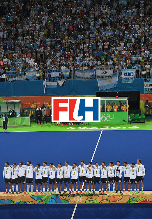 Argentina's players stand on the podium with their gold medals during the men's field hockey medals ceremony of the Rio 2016 Olympics Games at the Olympic Hockey Centre in Rio de Janeiro on August 18, 2016. / AFP / MANAN VATSYAYANA        (Photo credit should read MANAN VATSYAYANA/AFP/Getty Images)