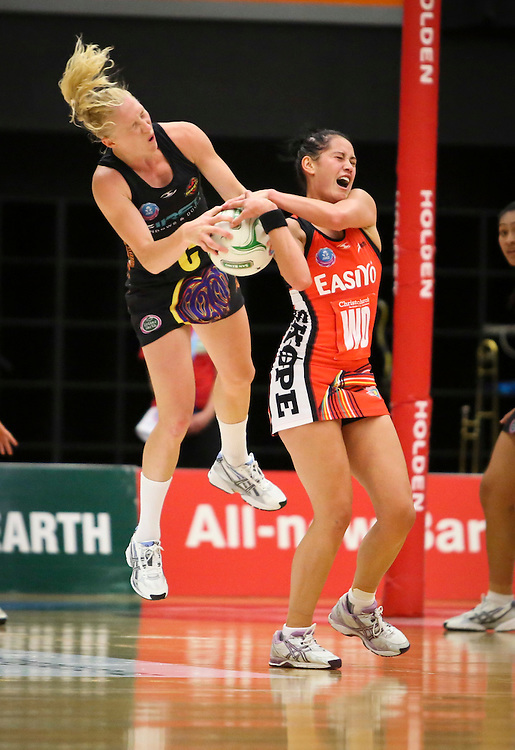 The Tactix Stacey Francis, right, tussles with the Magic's Laura Langman  in the teams ANZ Championship Netball match, Energy Events Centre, Rotorua, New Zealand, Monday, 30 April, 2012. Credit:SNPA / John Cowpland