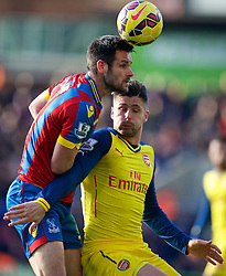 LONDON, ENGLAND - Saturday, February 21, 2015: Arsenal's Oliver Giroud and Crystal Palace's Joel Ward during the Premier League match at Selhurst Park. (Pic by David Rawcliffe/Propaganda)