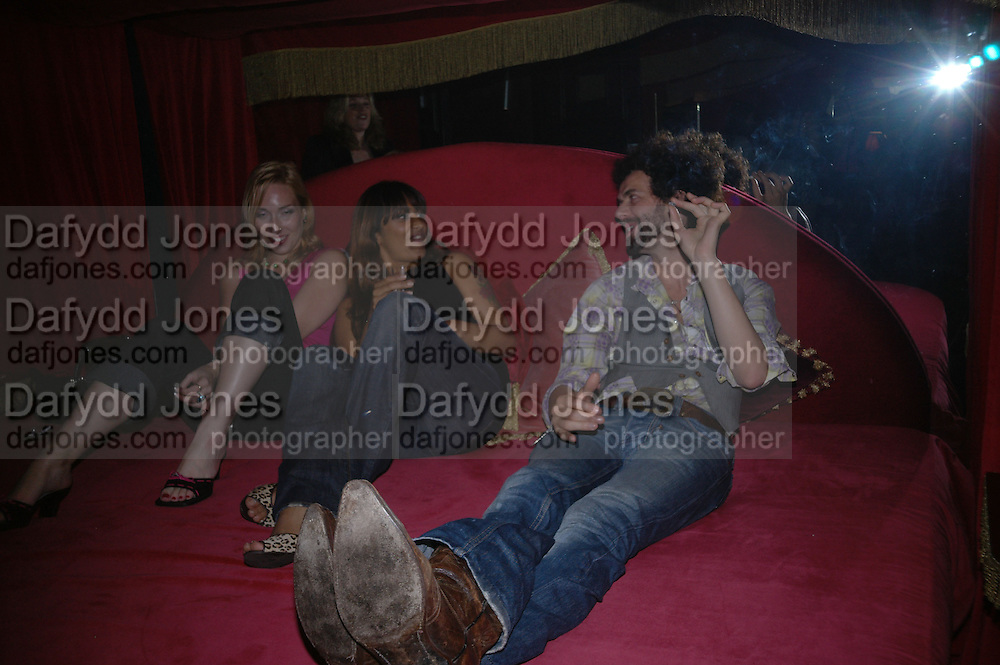 vip room. Cafe de Paris 80th birthday party. Coventry St. London 26 October 2005. October 2005. ONE TIME USE ONLY - DO NOT ARCHIVE © Copyright Photograph by Dafydd Jones 66 Stockwell Park Rd. London SW9 0DA Tel 020 7733 0108 www.dafjones.com