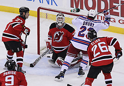 Mar 25, 2010; Newark, NJ, USA; New York Rangers center Chris Drury (23) scores the tying goal past New Jersey Devils goalie Martin Brodeur (30) in the last minute of the third period at the Prudential Center. The Rangers won 4-3 in an overtime shootout.