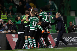 April 18, 2018 - Lisbon, Portugal - Sporting's head coach Jorge Jesus from Portugal (R ) celebrates the victory with the players after the Portugal Cup semifinal second leg football match Sporting CP vs FC Porto at the Alvalade stadium in Lisbon on April 18, 2018. (Credit Image: © Pedro Fiuza/NurPhoto via ZUMA Press)