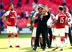 Santi Cazorla of Arsenal waves to the Arsenal fans as Mohamed Elneny of Arsenal hugs him - Mandatory by-line: Robbie Stephenson/JMP - 06/08/2017 - FOOTBALL - Wembley Stadium - London, England - Arsenal v Chelsea - FA Community Shield