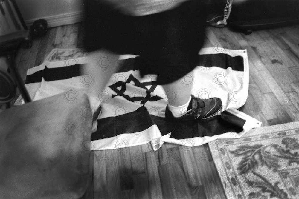 At the entrance of  house, of a neo-nazi member of White Revolution, an Israeli flag is used as a doormat.