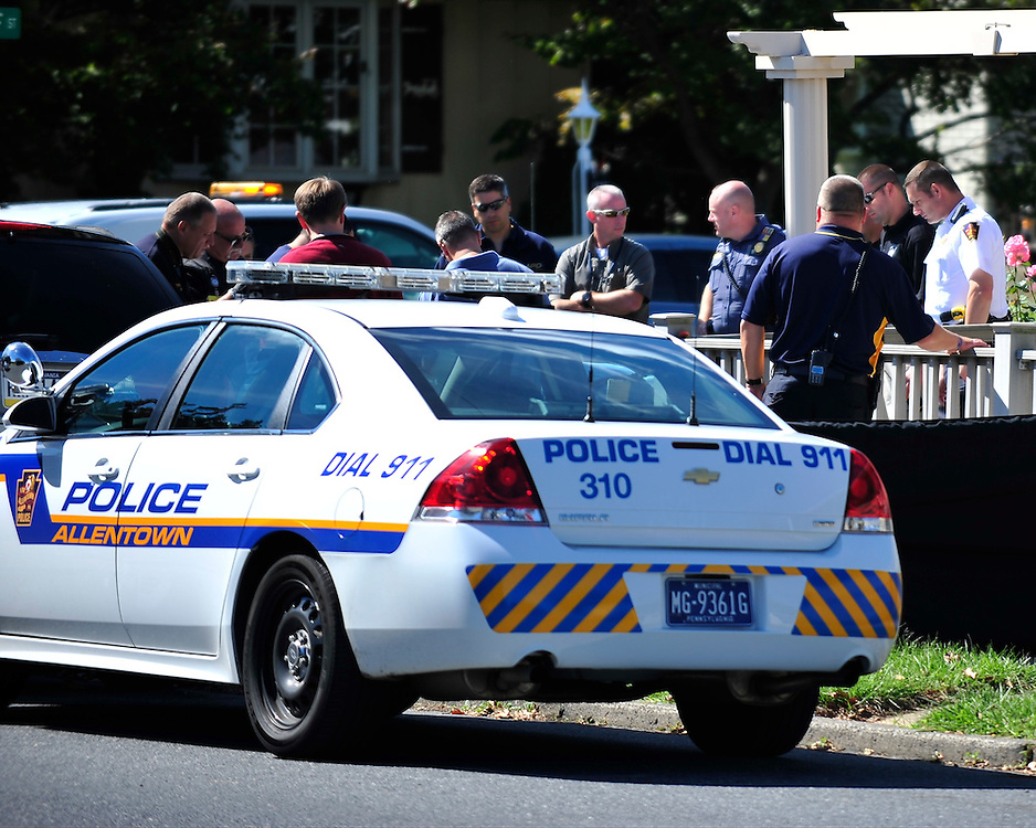 Police and representatives from the Lehigh County Coroners office respond to the intersections of Tacoma Street and East Greenleaf Street for a report of two people shot Sept. 14, 2014, in Allentown, Pennsylvania. (Chris Post | lehighvalleylive.com)
