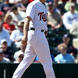 March 11, 2011; Fort Myers, FL, USA; Minnesota Twins first baseman Justin Morneau (33) reacts after striking out during a spring training exhibition game against the Boston Red Sox at Hammond Stadium.   Mandatory Credit: Derick E. Hingle