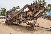 An antique wooden threshing machine is parked outdoors at the Eastern California Museum, 155 N. Grant Street, Independence, California, 93526, USA. The Museum was founded in 1928 and has been operated by the County of Inyo since 1968. The mission of the Museum is to collect, preserve, and interpret objects, photos and information related to the cultural and natural history of Inyo County and the Eastern Sierra, from Death Valley to Mono Lake.