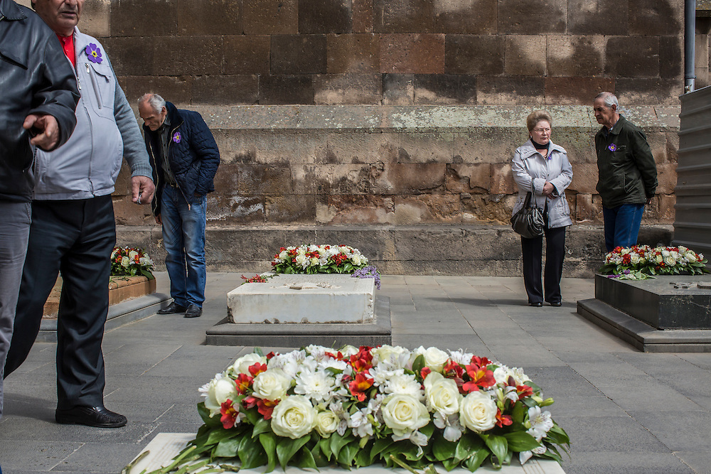 VAGHARSHAPAT, ARMENIA - APRIL 23: People gather to look at the tombs of priests outside Etchmiadzin Cathedral, which is the mother church of the Armenian Apostolic Church and is considered the oldest cathedral in the world, before a canonization ceremony for victims of the Armenian genocide on April 23, 2015 in Vagharshapat, Armenia. Tomorrow will mark the one hundredth anniversary of events generally considered to be the start of a campaign of genocide against minority ethnic Armenians living in present-day eastern Turkey by the Ottoman government over fears of their allegiance during World War I. (Photo by Brendan Hoffman/Getty Images) *** Local Caption ***