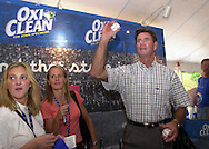 Baseball Hall of Fame pitcher Jim Palmer (R) tosses a basebal to a trivia contest winner at the OxiClean booth as part of the Little League World Series festivities, Sunday, August 25, 2002, in South Williamsport, Pennsylvania.  (Photo by William Thomas Cain/photodx.com)
