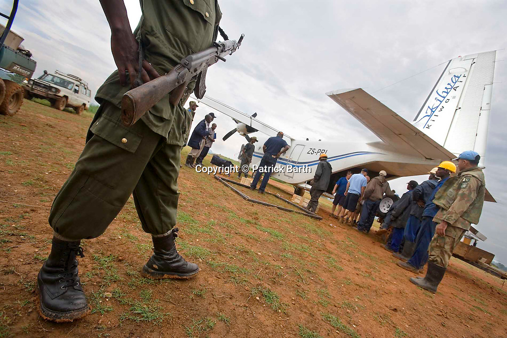 The plane is unloaded under the watchful eyes of the Congolese Army as well as the Pakistani UN forces.
