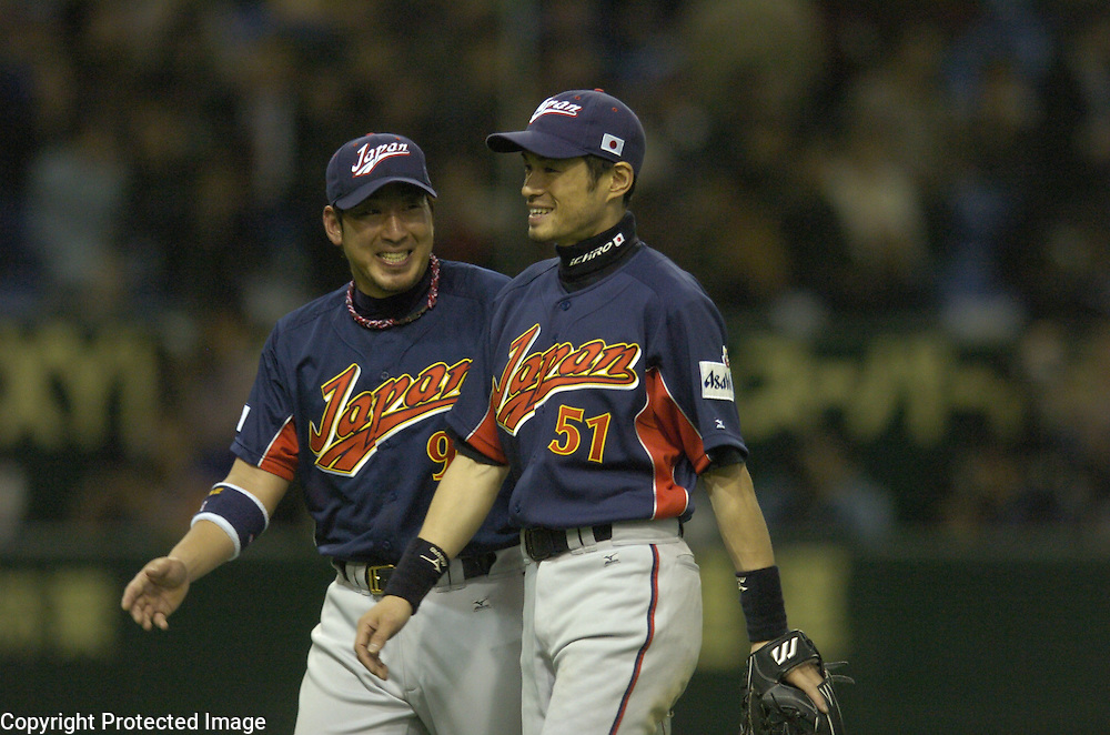 Team Japan's #9 Tatsuhiko Kinjoh and #51 Ichiro Suzuki smile after beating Team Chinese Taipei 14-3 in Game 4 of the World Baseball Classic at Tokyo Dome, Tokyo, Japan.