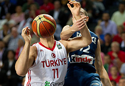 Oguz Savas of Turkey and Nando de Colo of France during  the eight-final basketball match between National teams of Turkey and France at 2010 FIBA World Championships on September 5, 2010 at the Sinan Erdem Dome in Istanbul, Turkey. (Photo By Vid Ponikvar / Sportida.com)