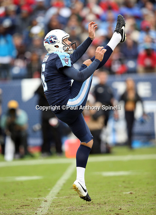 Tennessee Titans punter Brett Kern (6) jumps in the air as he punts during the 2015 week 7 regular season NFL football game against the Atlanta Falcons on Sunday, Oct. 25, 2015 in Nashville, Tenn. The Falcons won the game 10-7. (©Paul Anthony Spinelli)