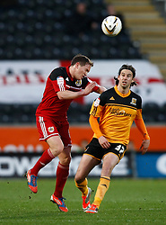 Bristol City's Neil Kilkenny clears from Hull's George Boyd- Photo mandatory by-line: Matt Bunn/JMP  - Tel: Mobile:07966 386802 19/04/2013 - Hull City v Bristol City - SPORT - FOOTBALL - Championship -  Hull- KC Stadium