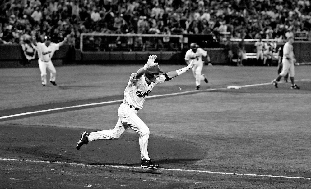 USC's Whit Merrifield drives in the winning run in the 11th inning during game two of the 2010 College World Series finals between South Carolina and UCLA at Rosenblatt Stadium in Omaha, Neb, Tuesday, June 29, 2010. The hit would score the winning run giving the Gamecocks their first NCAA baseball title.