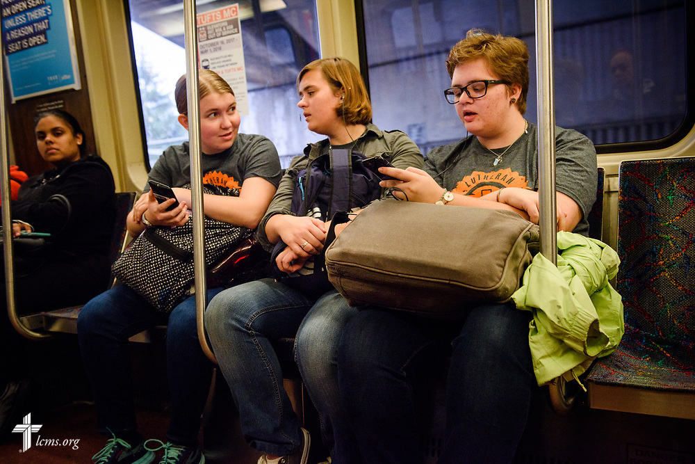 Young Adult Corps participants (L-R) Coretta Hedstrom, Rachel McCloskey, and Laura Grundeman ride the subway to a mission site on Wednesday, Oct. 25, 2017, in Boston. LCMS Communications/Erik M. Lunsford