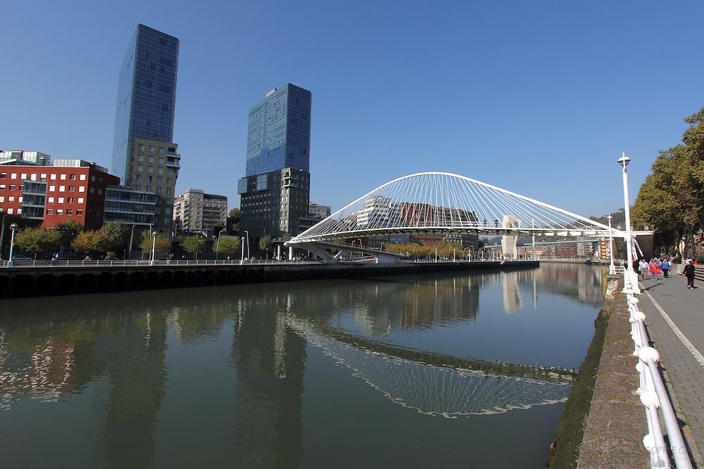 Pasarela Zubizuri (white bridge) straddles the river Nervión in Bilbao