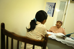 Counselor Reiny Hardjono talks to a young woman about reproductive health at a women's health clinic in Jakarta, Indonesia, April 20, 2006. A woman who has an abortion can get four years in jail while the doctor who performed it can get up to 15 years. Yet 2.3 million abortions are performed in Indonesia every year, many by unskilled practitioners. Thousands of women survive but often with life-long disabilities. It is said by doctors and activists that a woman dies every hour in Indonesia due to unsafe abortions.