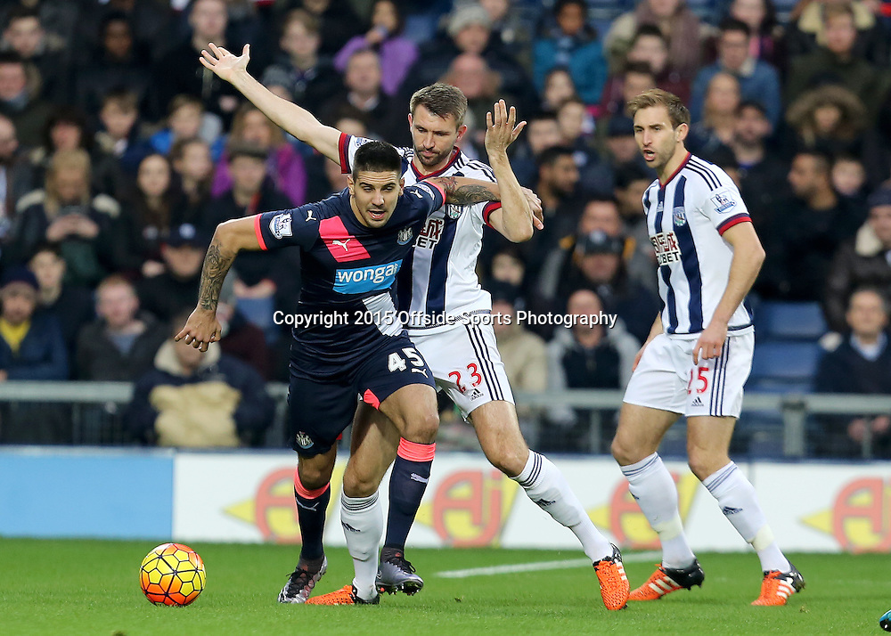 28th December 2015 - Barclays Premier League - West Bromwich Albion v Newcastle United - Aleksandar Mitrovic of Newcastle United battlees with Gareth McAuley of West Bromwich Albion - Photo: Paul Roberts / Offside.