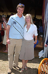 JACK KIDD and his wife BE at the Veuve Clicquot sponsored Gold Cup Final or the British Open Polo Championship held at Cowdray Park, West Sussex on 17th July 2005.<br /><br />NON EXCLUSIVE - WORLD RIGHTS
