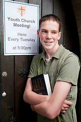 Teenager outside church.