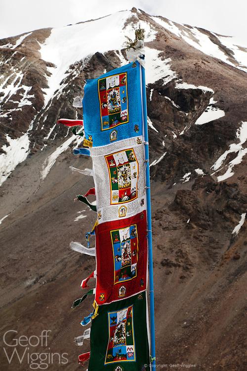 Tibetan prayer flags with Himalayan backdrop, Sarchu, Ladakh, Northern India