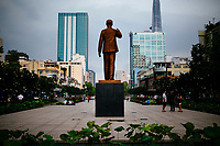 A view over a statue of Ho Chi Minh along Nguyen Hue Street in downtown Saigon, Vietnam.