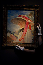 © Licensed to London News Pictures. 08/12/2011. London, UK. Dame Laura Knight's 'A Girl Reading' (est £100,000-150,000) a rare portrait of Florence Carter-Wood, (later Mrs Mannings) (whose tragic life story is to dramatized in a film titled 'Summer in February which will star Downton Abbey actor Dan Stevens) on display at Christie's where it will be auctioned off on 15th December, the auction is expected to realise in excess of £4.5million.  Photo credit : James Gourley/LNP