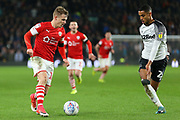 Barnsley striker Conor Chaplin (11) looks to get past Derby County defender Max Lowe (25) during the EFL Sky Bet Championship match between Derby County and Barnsley at the Pride Park, Derby, England on 2 January 2020.