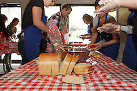 I spent an afternoon with the staff and their special guests at Jones and Salt Insurance during their annual sandwich making event for The Mustard Seed. They brought in 300 loaves of bread and severa huge buckets of peanut butter and jam and turned it all into sandwiches to donate. The sandwiches are used in the bagged lunches that the guests of the Mustard Seed take with them when they leave for the day. The event was lots of fun and it was really great to be able to participate and help out.<br /> <br /> &copy;2013, Sean Phillips<br /> http://www.RiverwoodPhotography.com