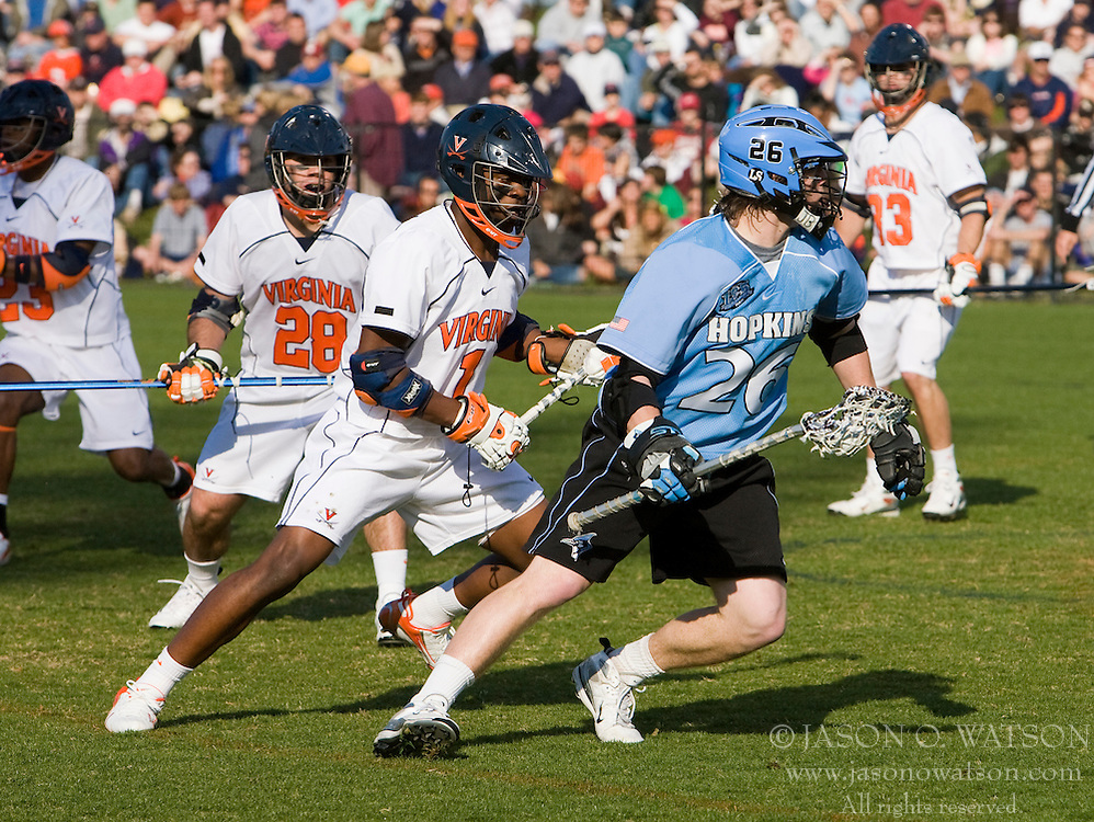 Johns Hopkins midfielder Mark Bryan (26) is defended by Virginia midfielder Shamel Bratton (1).  The #2 ranked Virginia Cavaliers defeated the #6 ranked Johns Hopkins Blue Jays 13-12 in overtime at the University of Virginia's Klockner Stadium in Charlottesville, VA on March 22, 2008.  The loss, in front of a record UVA crowd of 7,500, was the third consecutive overtime defeat for Hopkins, the defending national champions.