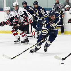 GEORGETOWN, ON  - APR 8,  2018: Ontario Junior Hockey League, South West Conference Championship Series. Game six of the best of seven series between Toronto Patriots and the Georgetown Raiders. Andrew Petrucci #21 of the Toronto Patriots battles for the puck during the third period.<br /> (Photo by Andy Corneau / OJHL Images)