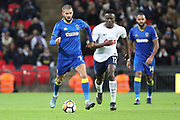 AFC Wimbledon defender George Francomb (7) dribbling away from Victor Wanyama of Tottenham Hotspur (12)  during the The FA Cup 3rd round match between Tottenham Hotspur and AFC Wimbledon at Wembley Stadium, London, England on 7 January 2018. Photo by Matthew Redman.