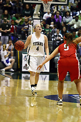 18 March 2011: Brittany Hasselbring moves past half court and is picked up by defender Bethany Morrison during an NCAA Womens basketball game between the Washington University Bears and the Illinois Wesleyan Titans at Shirk Center in Bloomington Illinois.