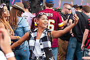 A festival attende takes a selfie during Clubhouse Festival 2018 at Laurel Park in Laurel, MD on Saturday, October 20, 2018.
