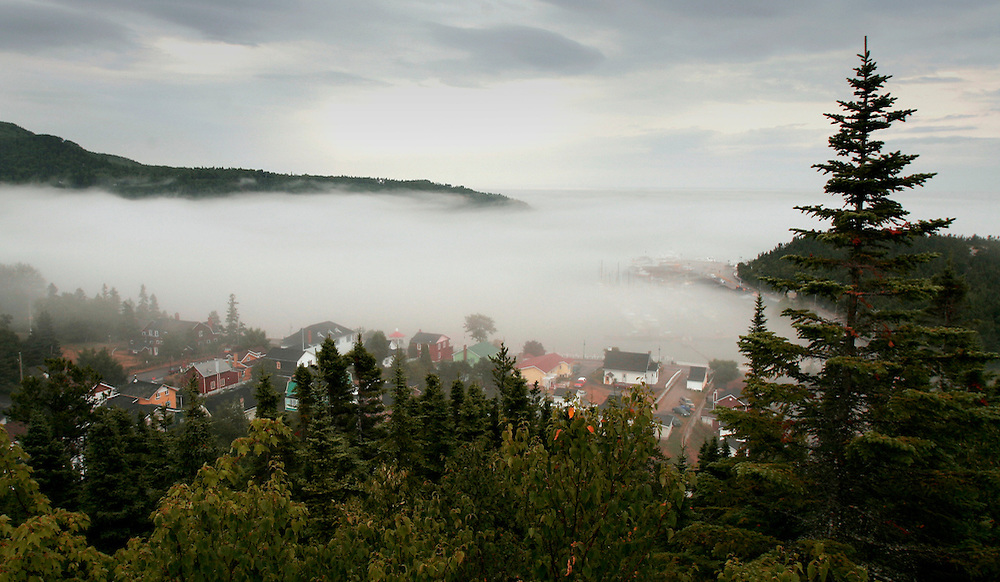 St. Lawrence, nws, lynn, 32.-A low layer of fog sits on top of the St. Lawrence River at Tadoussac, Quebec Canada.  At this point the river is a mixture of salt and fresh water.