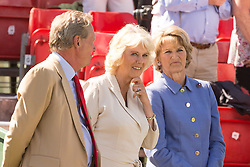 HRH The Duchess of Cornwall and the Duchess of Beaufort share a moment following the presentation of awards at the end of the Mitsubishi Motor Badminton Horse Trials 2013. Also in photo to the Duchess  right, Hugh Thomas, the event's director. Monday 06  May  2013.  Badminton, Gloucs, UK..Photo by: Mark Chappell/i-Images