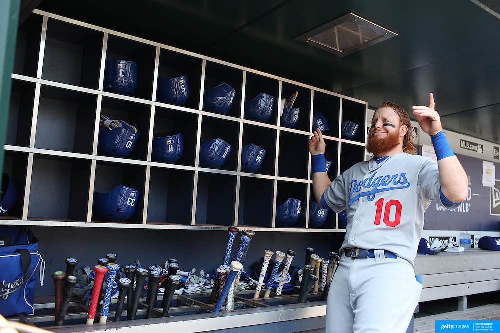 Justin Turner, Los Angeles Dodgers, jokes in the dugout withn team mates as he prepares to bat before the New York Mets Vs Los Angeles Dodgers MLB regular season baseball game at Citi Field, Queens, New York. USA. 26th July 2015. Photo Tim Clayton