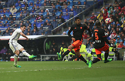 April 29, 2017 - Madrid, Spain - MADRID, SPAIN. APRIL 29th, 2017 - James shoots on goal. La Liga Santander matchday 35 game. Real Madrid defeated 2-1 Valencia with goals scored by Cristiano Ronaldo (26th minute) and Marcelo (86th minute). Parejo (82nd minute) scored for Valencia. Santiago Bernabeu Stadium. Photo by Antonio Pozo | PHOTO MEDIA EXPRESS (Credit Image: © Antonio Pozo/VW Pics via ZUMA Wire/ZUMAPRESS.com)