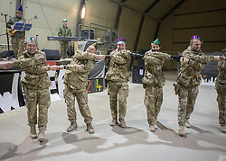 31/12/2013. Members of the Armed Forces welcomed in the final year of operations in Camp Bastion, Afghanistan this evening. Service men and women were entertained by a choir from the military hospital and a live band from the 3 Royal Horse Artillery. Photo credit: Alison Baskerville/LNP